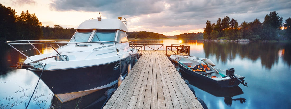 Wooden pier with boats at sunset