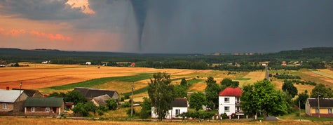 View of countryside with a tornado in the background