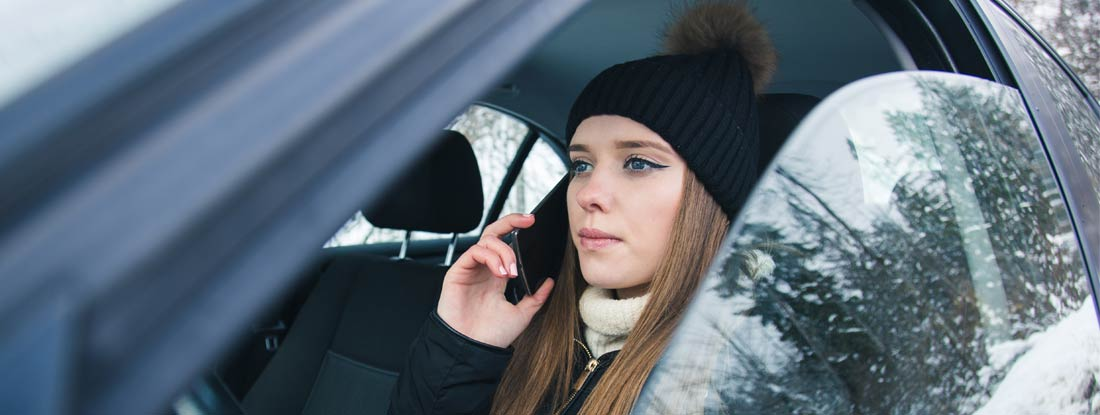 Distracted Driver Texting in Massachusetts winter