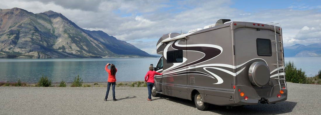 Mother and daughter traveling by RV in Yukon and Alaska. Find Alaska RV Insurance.
