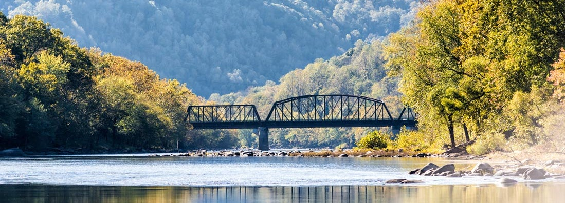 New River Gorge wide canyon water river lake during autumn by Grandview