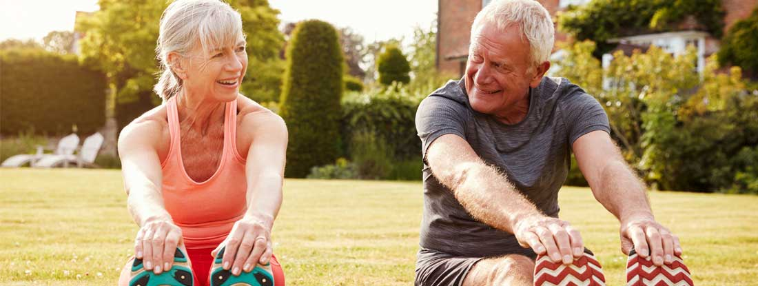 Healthy Senior Couple Exercising Together