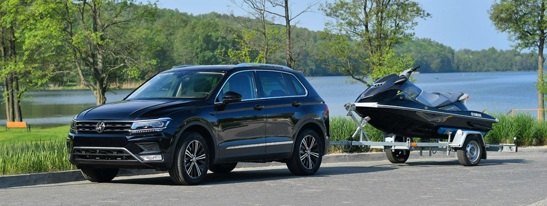 SUV with trailer and jet ski
