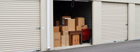Self storage warehouse with single storage unit open