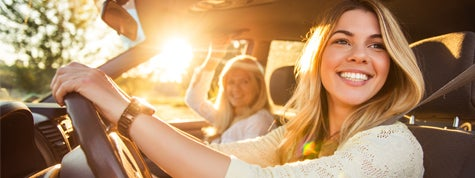 Teenage daughter and mother going on a family vacation in new car