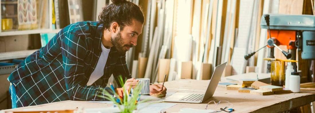 Carpenter Working Online In His Workshop