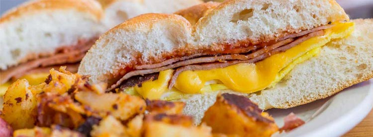Taylor ham, pork roll, egg and cheese breakfast sandwich with home fries from New Jersey
