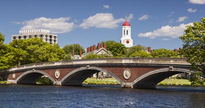 The dome of Harvard University's Dunster House and John W. Weeks Bridge over Charles River in Cambridge Massachusetts