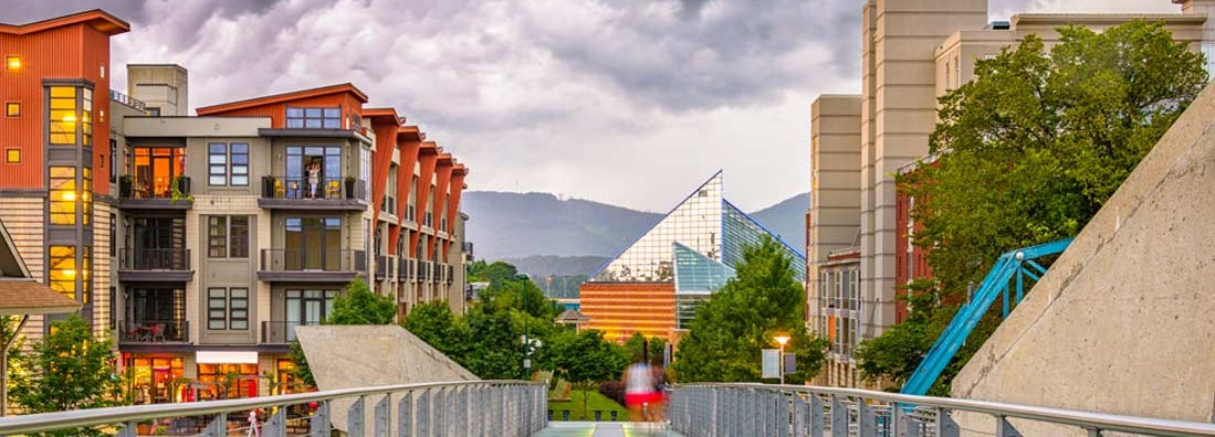 Chattanooga, Tennessee downtown walking path and cityscape at twilight. Find Tennessee renters insurance.