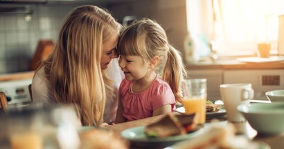 Picture of a mother and daughter having breakfast