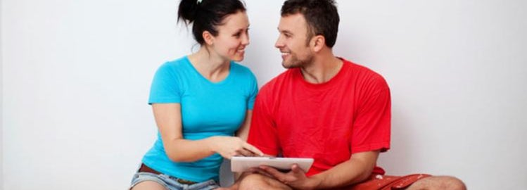 young married couple in new home