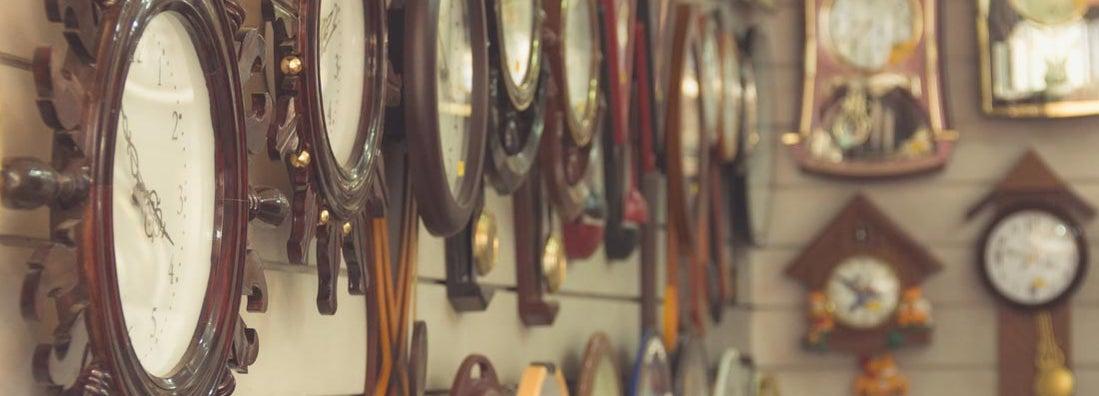 Clocks hanging on wall at clock shop