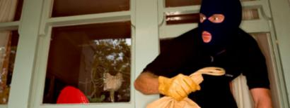 Burglar leaving home through window