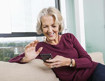 Older Woman on her cell phone