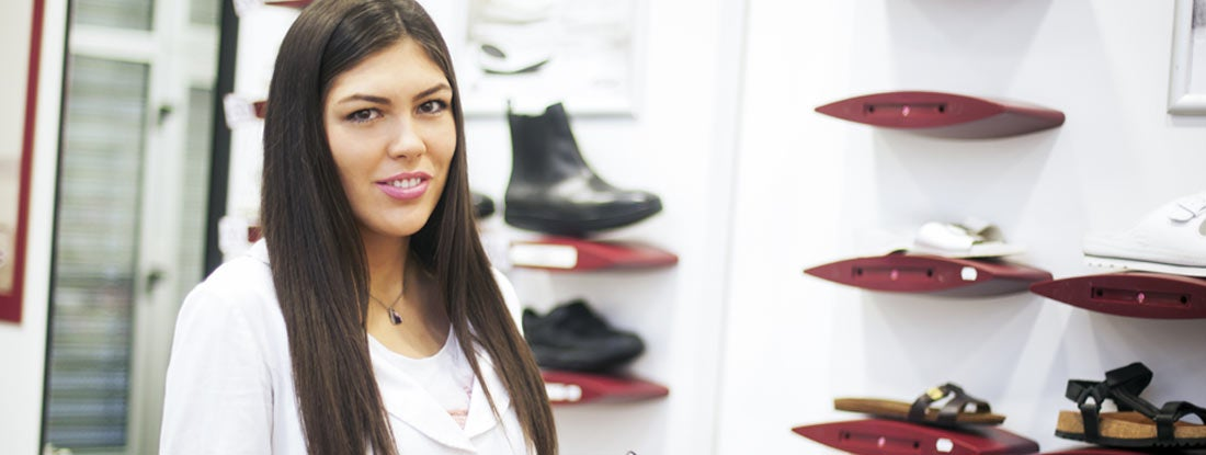 Healthcare worker holding orthopedic shoe in an orthopedic shoe store.