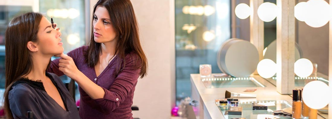 Cosmetologist applying makeup
