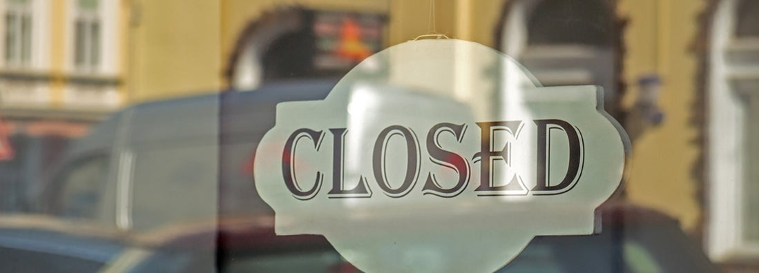 Closed sign on shop glass front door