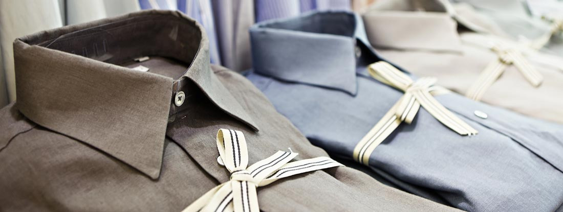 Smart shirts tied with striped ribbon in exclusive menswear store
