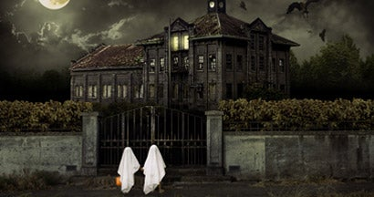 Children in Ghost Costumes Trick or Treat at Haunted House
