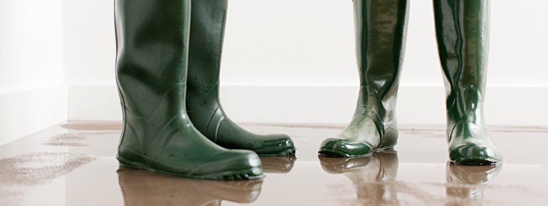 Couple in boots on flooded floor