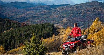 riding an atv in the mountains