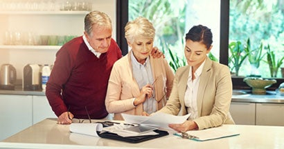 Senior couple getting advice from their financial consultant about purchasing an annuity