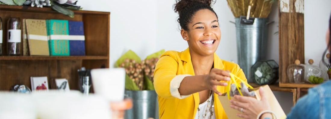 Retail sales woman helping customer
