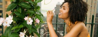 Girl living in the city enjoying her urban garden