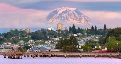 Mount Rainier over Tacoma WA waterfront during sunset evening