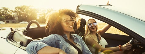 Young adults traveling in car and having fun