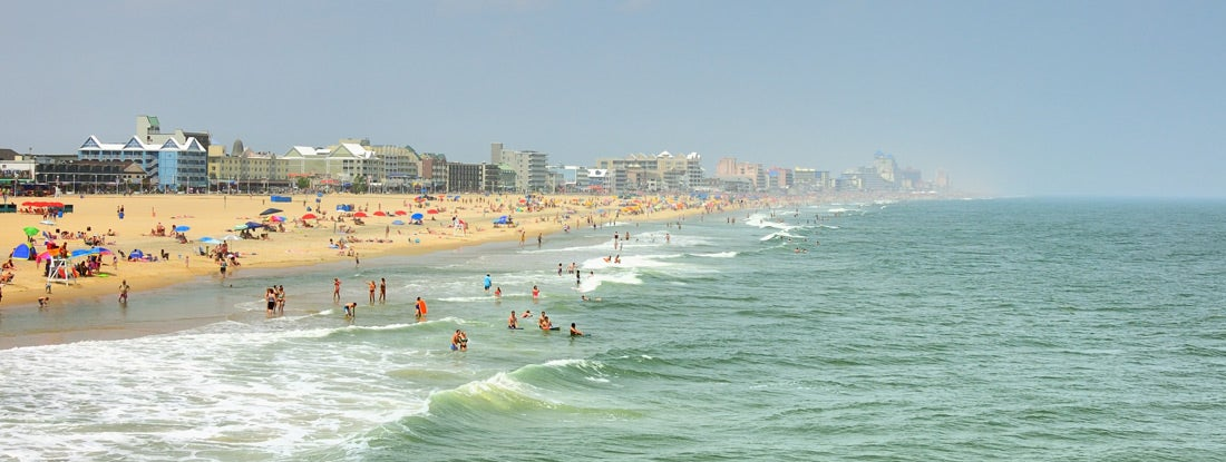 Ocean City, Maryland Skyline And Tourists On Beach