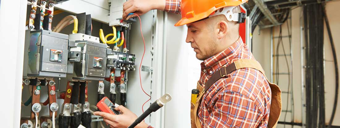 electrical contractor in front of fuse switch board