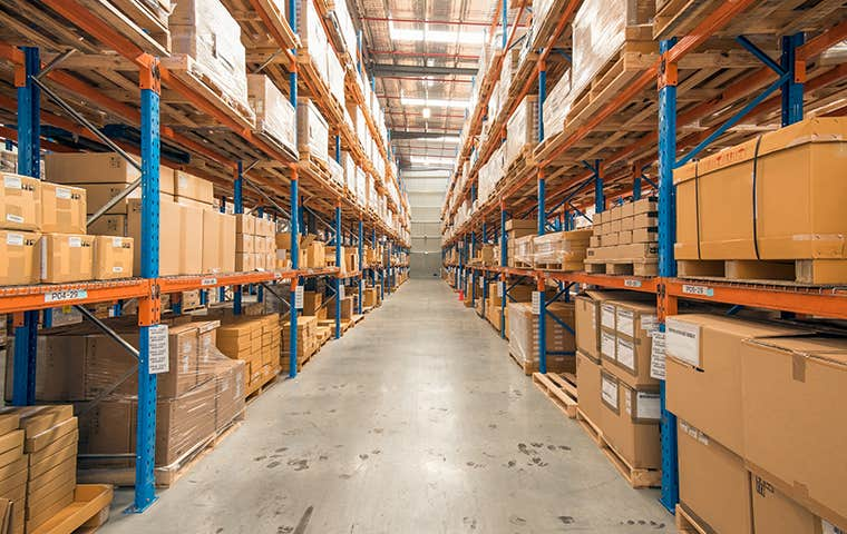a large warehouse with boxes on shelves