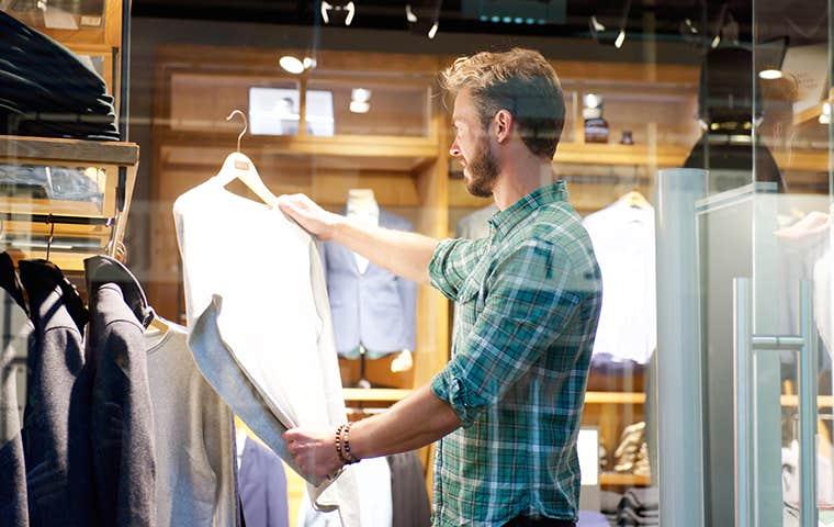a man buying a dress shirt