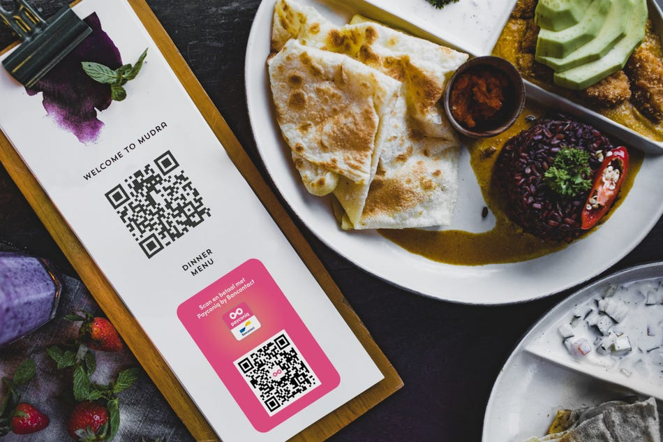 A Payconiq and digital menu QR code on every table