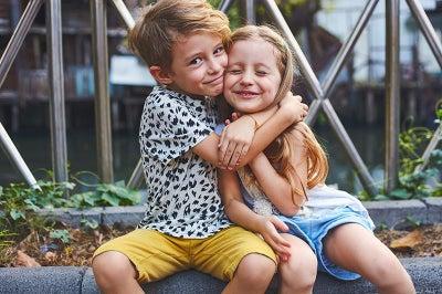 Young boy and girl hug.