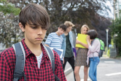 Young boy appears to feel left out as if bullied.