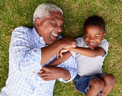 A grandad plays with his grandson.