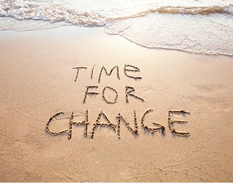 Time for change is written in beach sand.