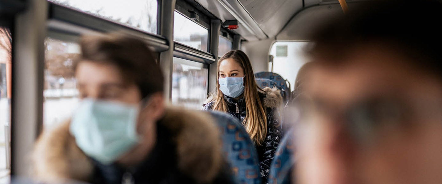 People on bus wearing face masks