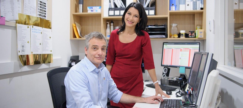 Man and woman at computer screen