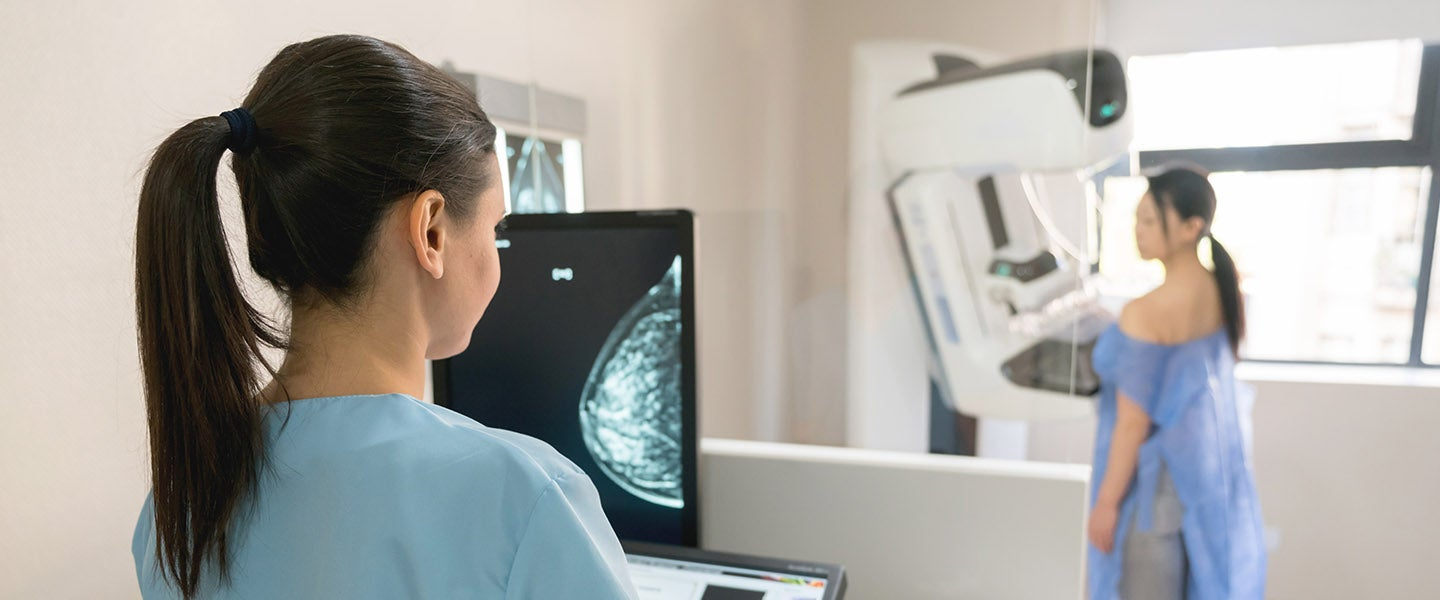 Woman having mammogram with screen in foreground