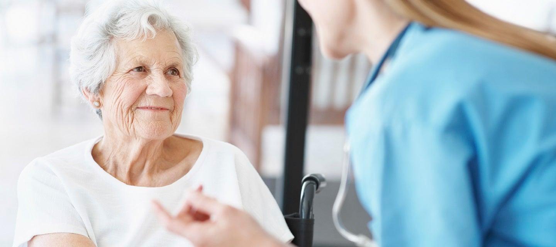 Elderly patient being comforted by nurse