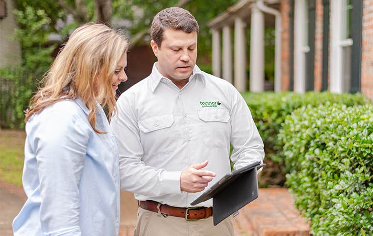 tech talking with a homeowner