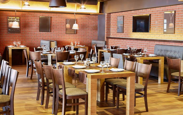 a fancy restaurant with wood tables and chairs