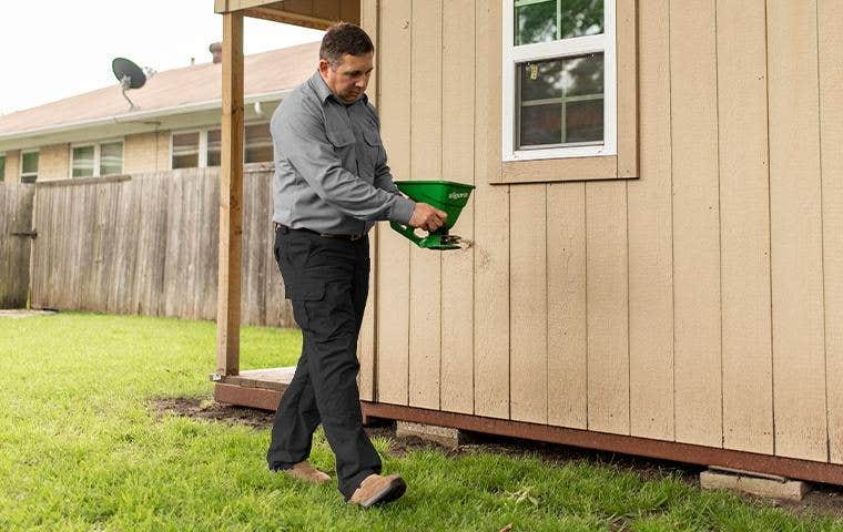 technician applying treatment to a house in colorado