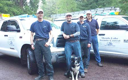 technicians with company vehicles and dog