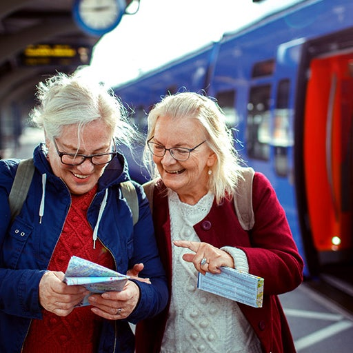 Elderly mother with daughter getting a train