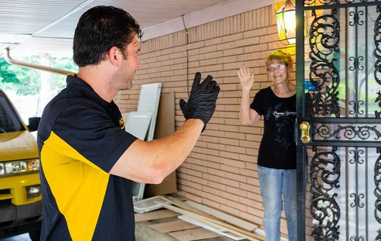 technician waving to homeowner