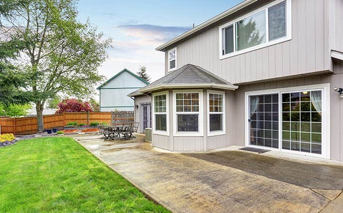 nice house with patio area and lawn